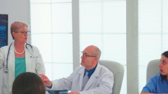 Neurologist Reading Brain Waves on Monitor