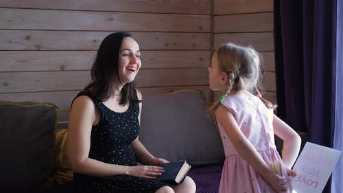 Little Girl Congratulates Mother with Holiday