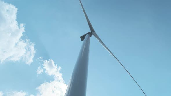 Wind Turbine Against the Sky in Motion