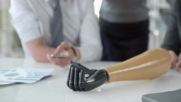Thumbnail for Smartphone Controlled Bionic Hand Moving Fingers on Office Table