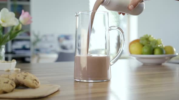 Cover Image for Pouring Chocolate Milk In To Jug