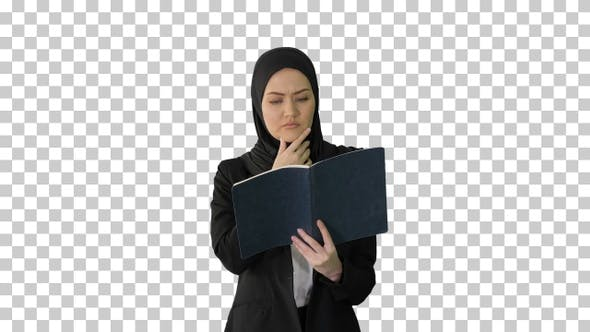 Thumbnail for Muslim Businesswoman reading her business, Alpha Channel