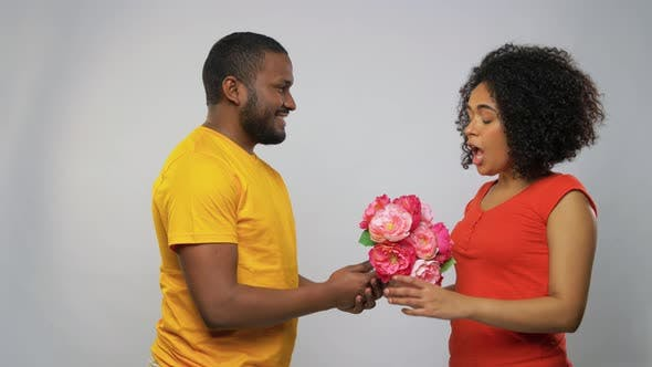 Thumbnail for Happy African American Couple with Flowers