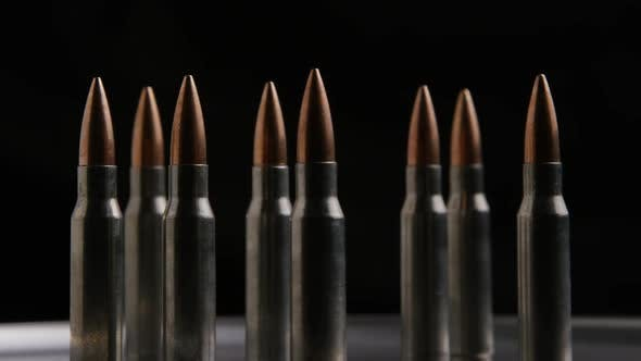 Cinematic rotating shot of bullets on a metallic surface - BULLETS 010