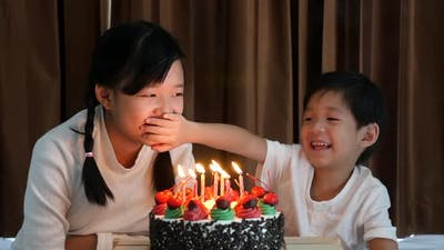 Asian Children With Birthday Cake