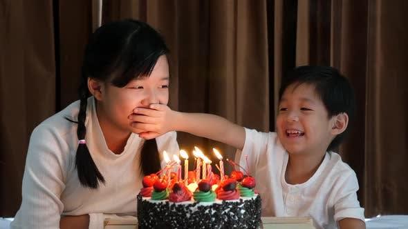 Asian Children With Birthday Cake