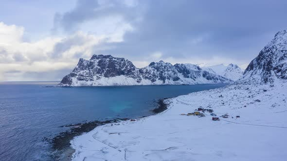 Uttakleiv Beach and Mountains in Winter. Lofoten Islands, Norway. Aerial View