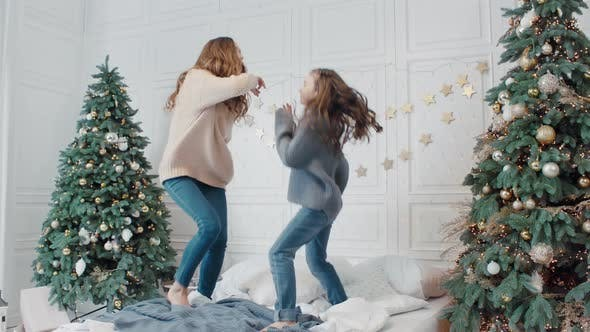 Thumbnail for Happy Mother and Daughter Making Dance Party on Bed in Private House.