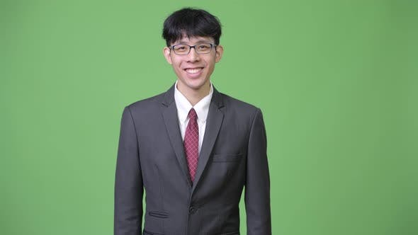 Thumbnail for Young Happy Asian Businessman Smiling