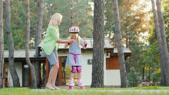 Thumbnail for Actively Spend Time with Children. Mom Teaches To Skate His Daughter
