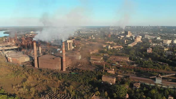 Thumbnail for Aerial View of the Industrial Plant with Smoking Pipes Near the City. Industrial Zone