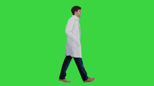 Thumbnail for Male Doctor in White Coat Walking with Hands in Pockets Looking Straight Ahead on a Green Screen
