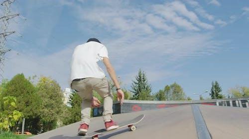 Skateboarder performing tricks in skatepark