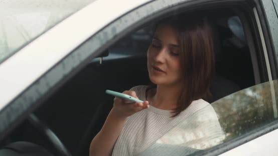 Thumbnail for Happy Woman Sitting Inside Car Using a Smart Phone Voice Recognition Function Online Outdoors Speech