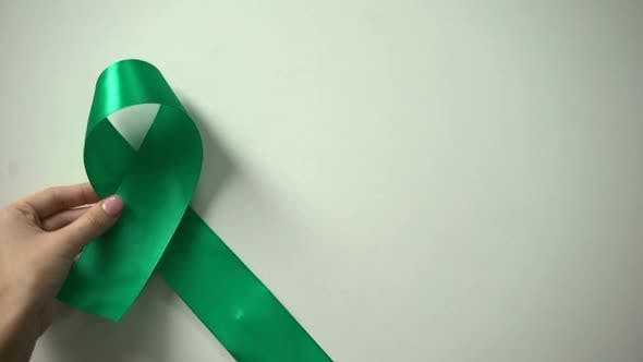 Thumbnail for World Mental Health Day Inscription, Green Ribbon on Table, Awareness Campaign