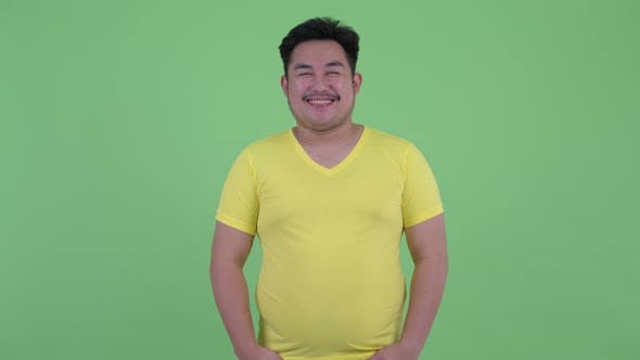 Thumbnail for Happy Young Overweight Asian Man Smiling