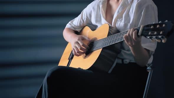 Thumbnail for Girl Playing Guitar at Studio