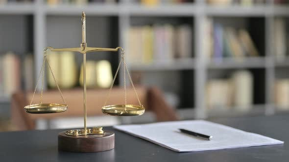 Thumbnail for Gold Brass Balance Scale with Document on Lawyer Table