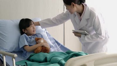 Doctor with child girl patient