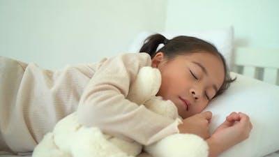 Asian Preschooler Sleeping on Bed at Home