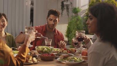 Friends Are Having Festive Dinner
