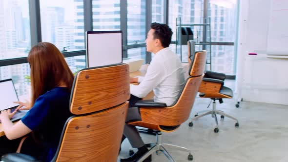Thumbnail for Portrait of happy Asian businesswoman arms crossed and smile in startup company office