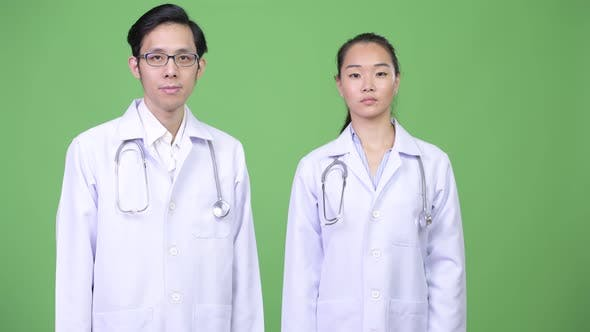 Young Happy Asian Couple Doctors Together