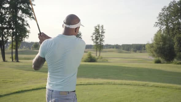 Thumbnail for Portrait Handsome Successful Middle Eastern Golfer Swinging and Hitting Golf Ball on Beautiful