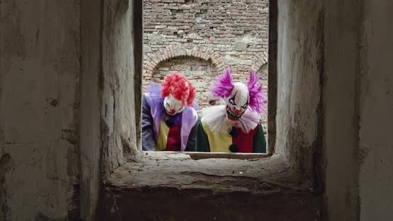 Two scary clowns look out the window
