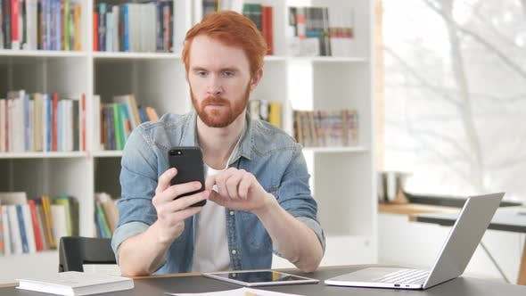 Thumbnail for Casual Redhead Man Using Internet on Smartphone