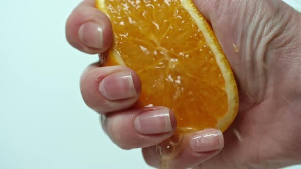 Thumbnail for Close-up of orange squeezed