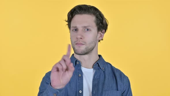 Thumbnail for No Gesture By Young Man, Finger Sign on Yellow Background