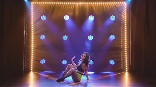 Female Dancer Shakes Ass and Moves Hips Dancing Twerk