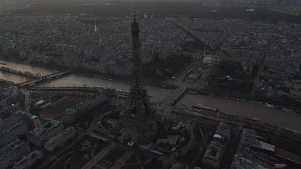 Cover Image for AERIAL: Drone Slowly Circling Eiffel Tower, Tour Eiffel in Paris, France with View on Seine River in