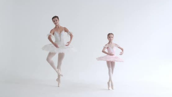 Female and Little Girl in a White Tutu Dance Ballet and Perform Choreographic Elements