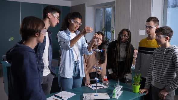 Interested Teen Pupils Observing Chemical Reaction