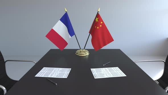 Thumbnail for Flags of France and China and Papers on the Table