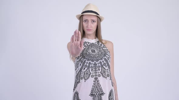 Cover Image for Portrait of Stressed Blonde Tourist Woman Showing Stop Gesture
