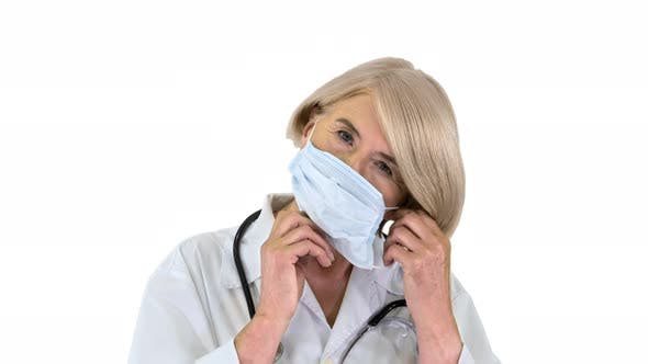 Thumbnail for Elderly Woman in a Medical Mask with a Stethoscope on White Background