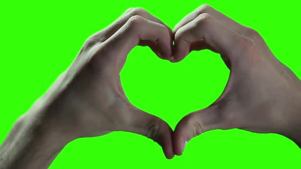 Hands making a Heart over Green Screen.