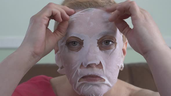 Thumbnail for Portrait of Mature Woman in Facial Mask for Face. Cosmetic Procedure Skin Care. Emotion