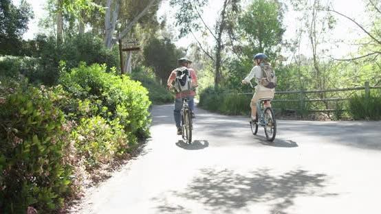 Thumbnail for Senior couple riding bikes on trail