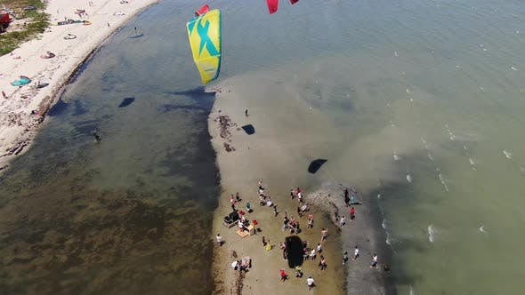 Thumbnail for Aerial Footage of Kitesurfers and People on the Shore, Sunny Day,
