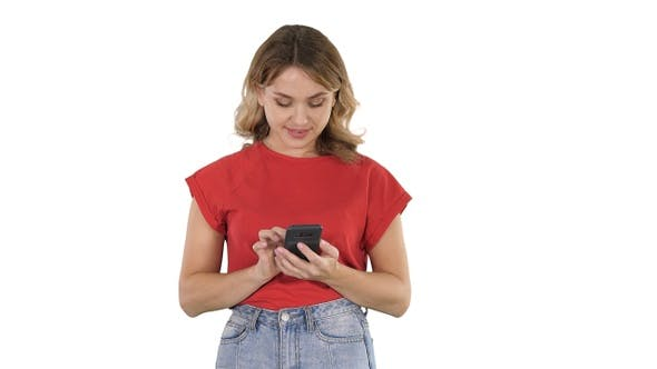 Thumbnail for Young Beautiful Woman in T Shirt Using Her Smartphone On