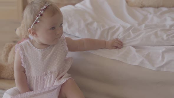 Thumbnail for Small Baby Girl Playing on the Bed Indoors