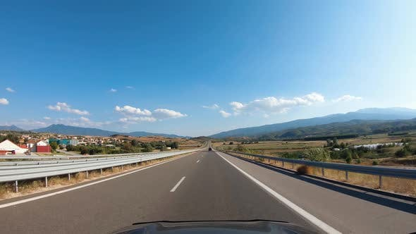Road Trip on Europe Firstperson View of a Moving Car on a Highway Summer Mountains Natural Landscape