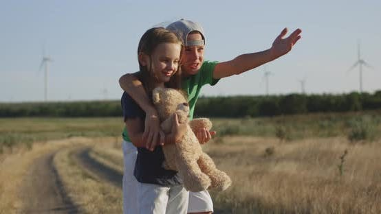 Thumbnail for Brother and Sister Looking Far Away in Field