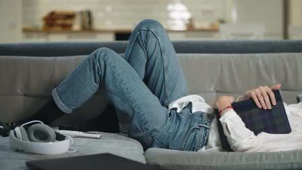 Thumbnail for Tired Woman Sleeping on Sofa at Modern Kitchen. Relaxed Woman Hugging Photoalbum