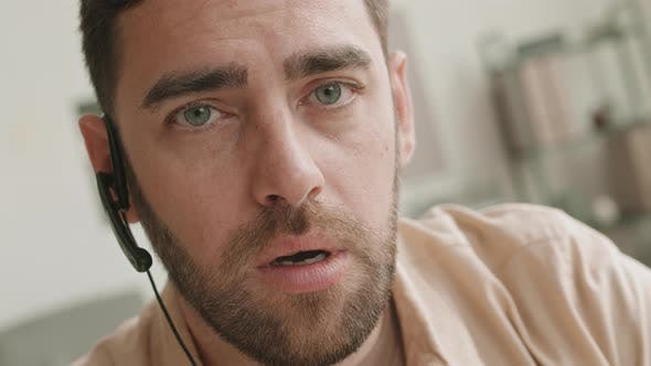 Thumbnail for Guy Talking on Headset