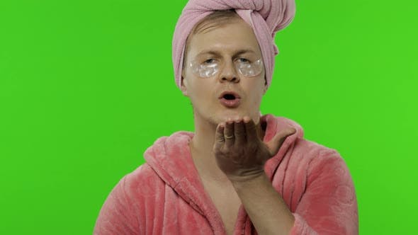 Thumbnail for Transsexual Man in Bathrobe and Eye Patches Sends Fly Kisses. Chroma Key